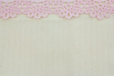 Lace flowers frame close up isolated on Fabric texture Stock Photo - 17469113