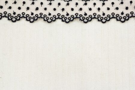 Lace flowers frame close up isolated on Fabric texture Stock Photo - 17469031