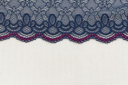 Lace flowers frame close up isolated on Fabric texture Stock Photo - 17469152