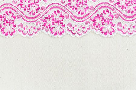 Lace flowers frame close up isolated on Fabric texture Stock Photo - 17469083