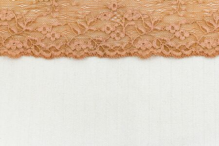 Lace flowers frame close up isolated on Fabric texture Stock Photo - 17469118