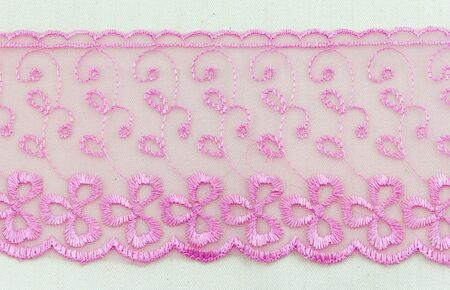 Lace flowers frame close up isolated on Fabric texture Stock Photo - 17469060
