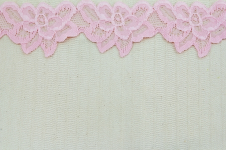 Lace flowers frame close up isolated on Fabric texture Stock Photo - 17469088