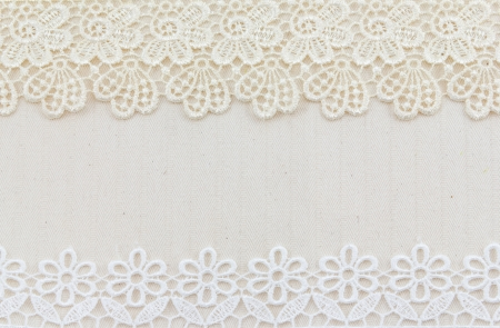 Lace flowers frame close up isolated on Fabric texture photo