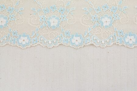 Lace flowers frame close up isolated on Fabric texture Stock Photo - 17469049