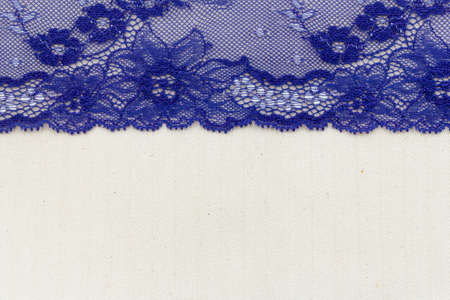 Lace flowers frame close up isolated on Fabric texture Stock Photo - 17469115