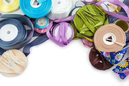 many-coloured  satin ribbons spools in the craft Stock Photo - 17469042