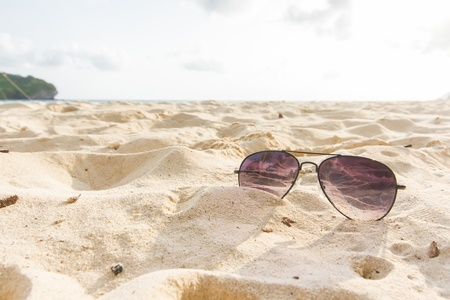 Sunglasses on the sand beach in South of thailand