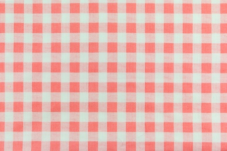 a background texture of Orange plaid fabric photo
