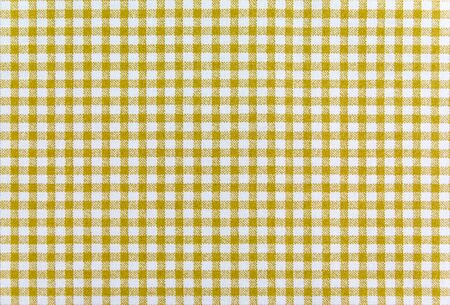 a background texture of yellow plaid fabric photo