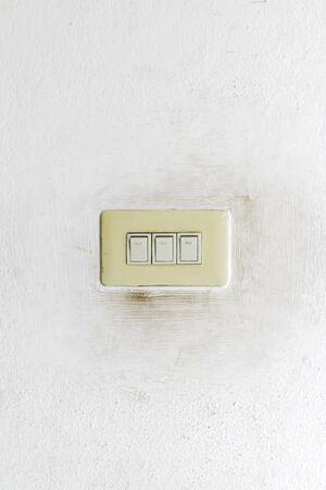 Light switch on grunge wall photo