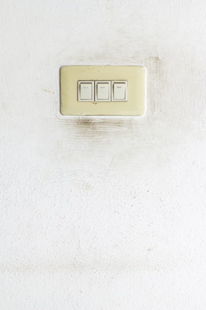 switch on the light: Interruptor ligero en la pared del grunge Foto de archivo