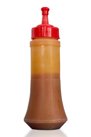 squirting ketchup: Plastic chilli sauce bottles  on white background