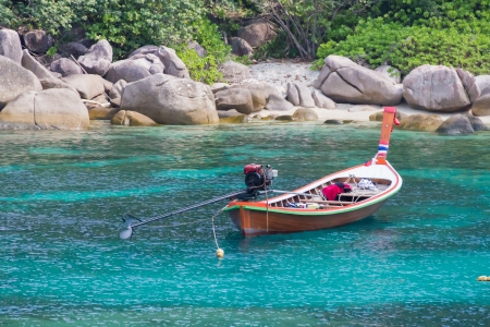 Longtail boat on beach of koh tao in the gulf of thailand photo