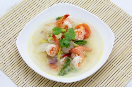 Tom Yum Goong served in white bowl photo
