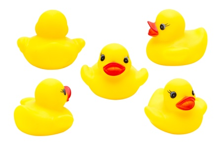 Cute yellow rubber duck isolated over white background Stock Photo - 19577179