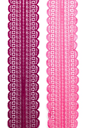 Pink Lace Fabric on white background Stock Photo