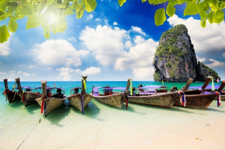 longtail: Long tail boat on tropical beach with limestone rock, Krabi, Thailand