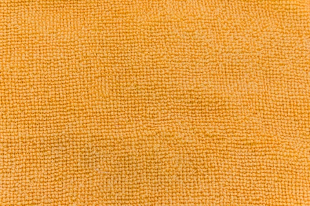Texture of orange microfiber fabric photo
