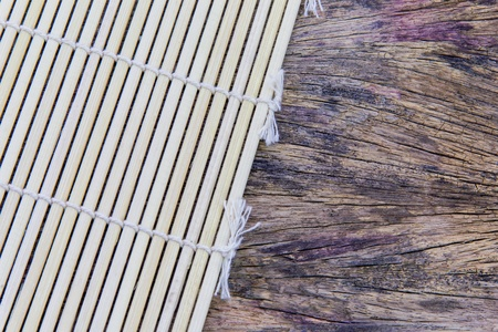 Bamboo mat on the Old wooden floor background
