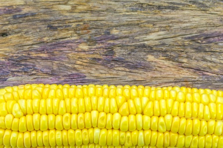 Ripe corn on a wooden table Stock Photo