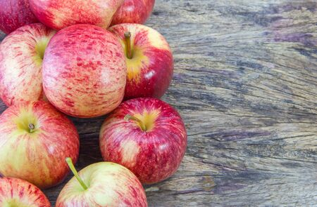 Red apples in wooden background with Copyspace
