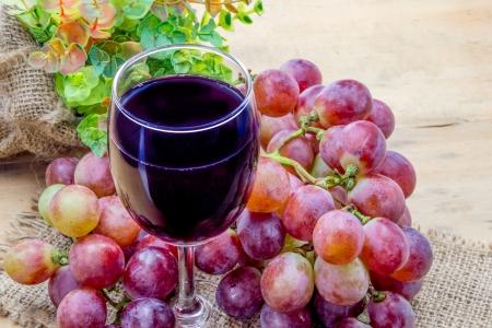 Glass of grape juice and grape fruit Stock Photo
