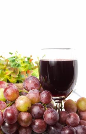 and grape juice: Glass of grape juice and grape fruit