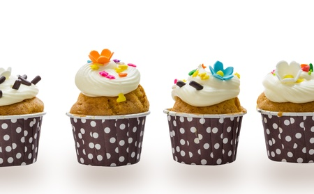 Cupcakes with cream isolate on white background photo
