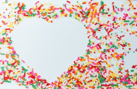 Heart shaped made from colored sprinkles photo