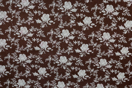Fragment of retro tapestry textile pattern with floral ornament useful as background photo