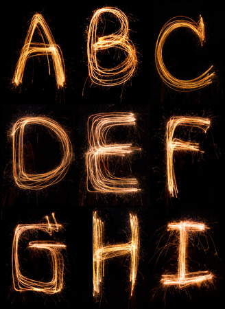 sparkler firework light alphabet  A-I Stock Photo