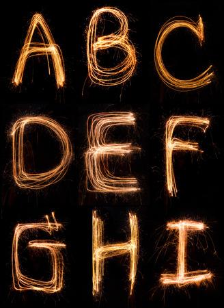 sparkler firework light alphabet  A-I Stock Photo