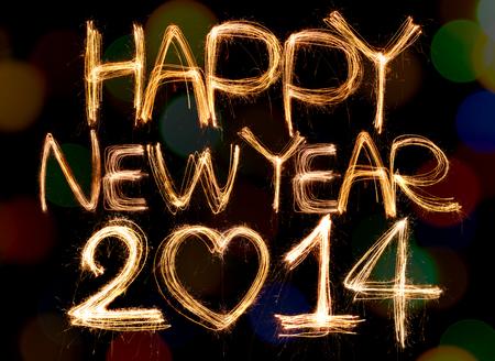 frohes neues jahr: Frohes neues Jahr mit Sekt Zahlen auf Bokeh Hintergrund geschrieben