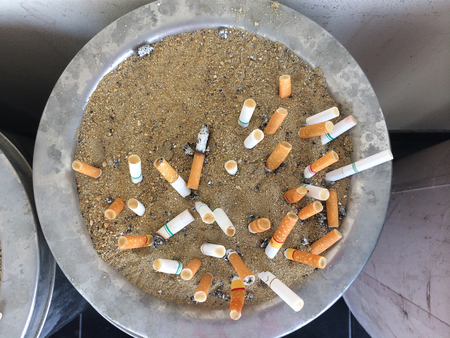 closeup of many dirty cigarettes butts background photo