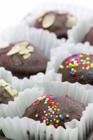 A pack of Chocolate balls with colourful topping photo