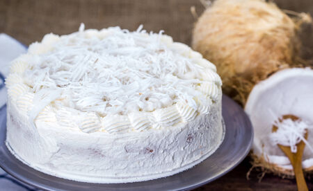 whipped cream: Homemade Coconut cream cake with coconut fruit Stock Photo