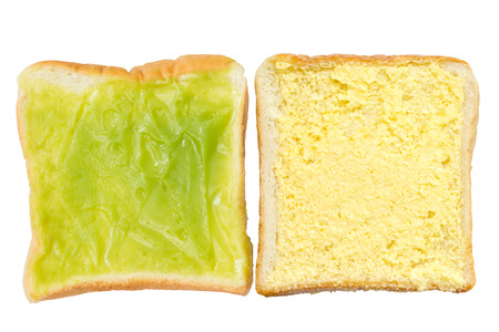 Bread Buttered and Sliced custard bread  on white background photo