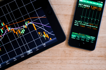 market crash: Macro view of stock market application on touchscreen smartphone Stock Photo