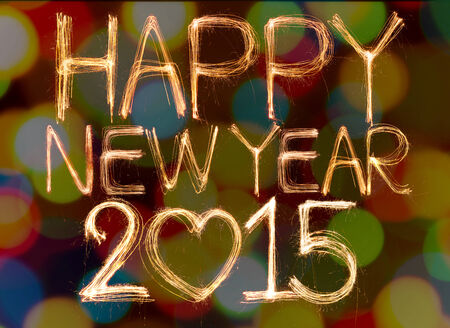 Happy new year 2015 written with Sparkling figures on bokeh background photo