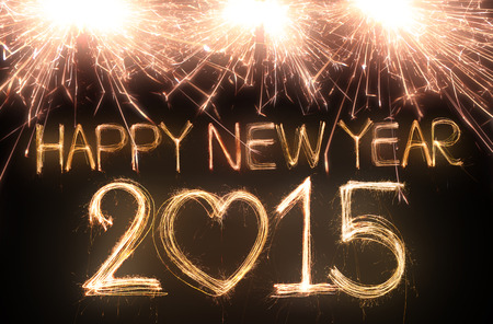 Happy new year 2015 written with Sparkle firework photo
