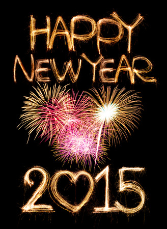 Happy new year 2015 written with Sparkling figures and fireworks