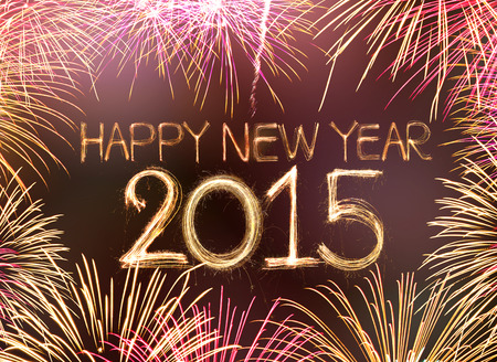 Happy new year 2015 written with Sparkling figures and fireworks photo