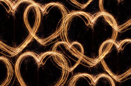 Heart sparkler firework background
