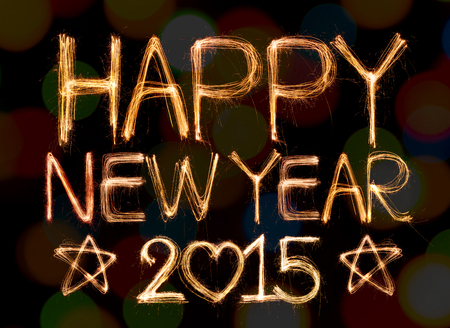 Happy new year 2015 written with Sparkle firework on bokeh background photo