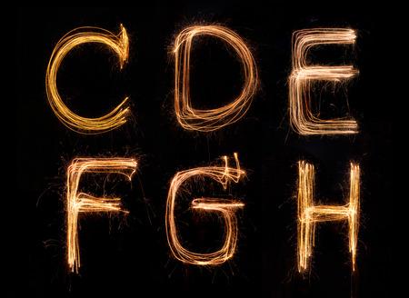 Sparkler firework light alphabet C-H