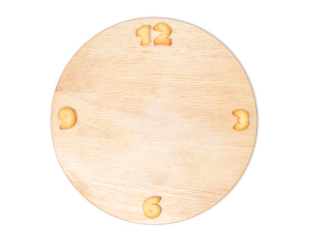 Clock made of wooden background. eating time concept photo