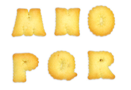 Cookies ABC containing letters, numbers, signs and symbols isolated on white background photo