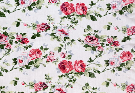 Fragment of colorful retro tapestry textile pattern with floral ornament photo