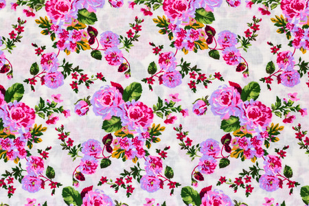 Fragment of colorful retro tapestry textile pattern with floral ornament useful as background photo